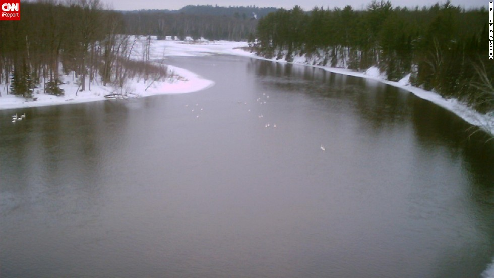 "On a cold day in March 2006, <a href=""http://ireport.cnn.com/docs/DOC-1150901"">Stephen Messenger</a> photographed the Au Sable River from a highway bridge in Oscoda, Michigan. The river runs 138 miles and empties out into Lake Huron. You can see this sprawling river from the many lookout platforms built by the U.S. Forest Service throughout Michigan. <br /><strong><br />Desktop viewers: Click the double arrow to see more photos.</strong>"