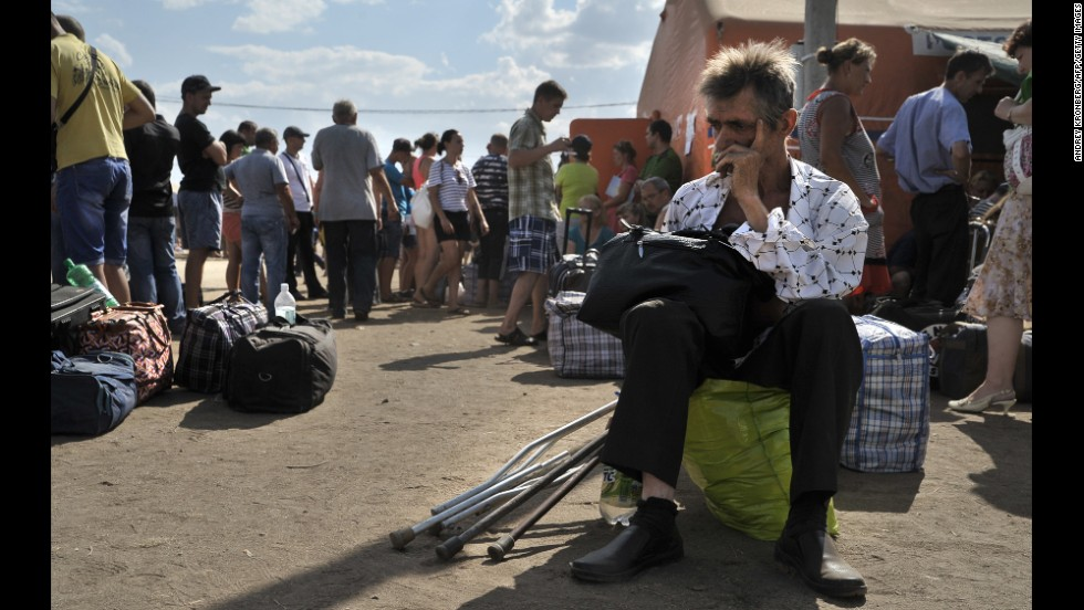 Refugees from southeastern Ukraine wait at a refugee camp in Donetsk on Wednesday, August 6.