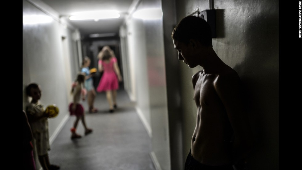 A boy stands in a hallway of a refugee hostel run by pro-Russian rebels in Donetsk on Monday, August 4.
