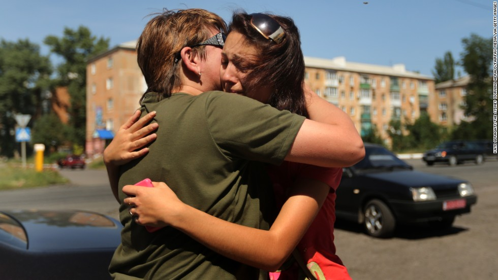 "A woman says goodbye to her mother as she flees her home in Shakhtersk, Ukraine, on Tuesday, July 29. <a href=""http://www.cnn.com/2014/05/27/world/gallery/ukraine-after-election/index.html"">See more photos of the crisis from earlier this year</a>"