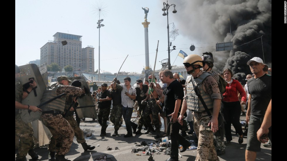 Activists in Kiev, Ukraine, clash with a police battalion in Independence Square on Thursday, August 7. Demonstrators had confronted city workers who were attempting to clear the square.