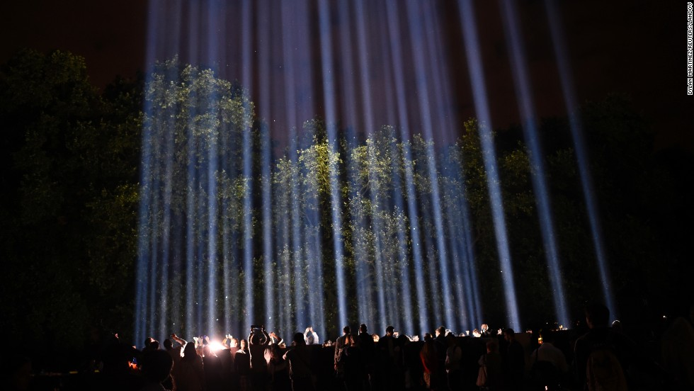 "People in London enjoy ""Spectra,"" a presentation by Japanese visual artist Ryoji Ikeda, during World War I commemorations on Monday, August 4. Lights across Britain were switched off for an hour to pay tribute to those who died in the war. The illuminations from ""Spectra"" will light up London's skyline for seven nights. <a href=""http://www.cnn.com/2014/08/01/world/gallery/week-in-photos-0801/index.html"">See last week in 33 photos</a>"