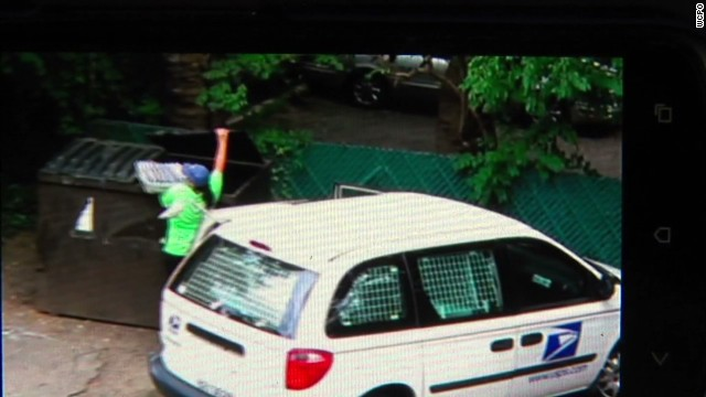 pkg postal worker delivers mail to dumpster_00000129.jpg