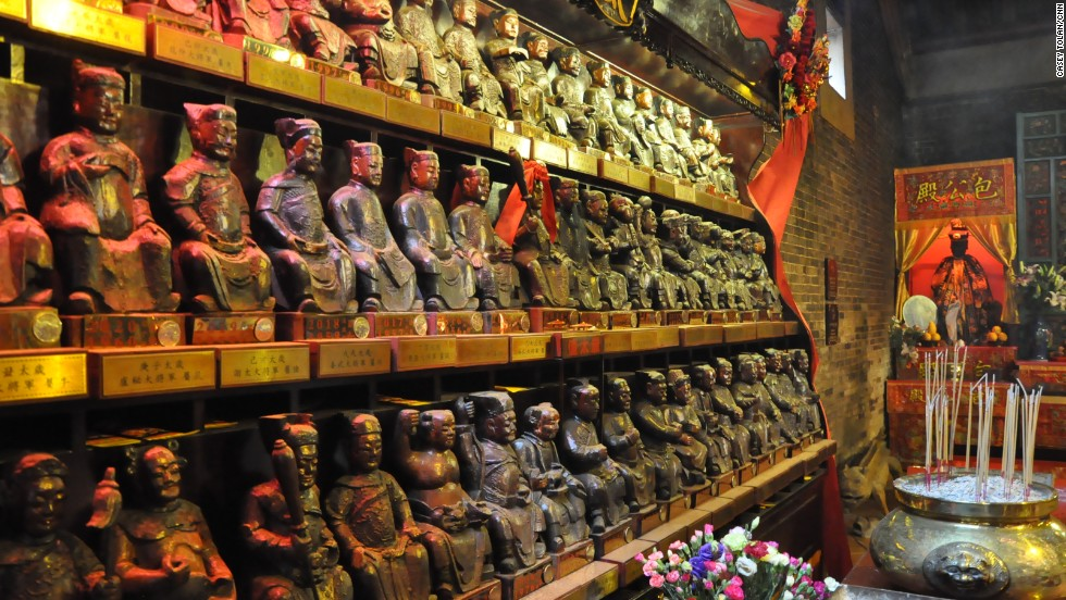 Small statues line the walls at Pak Tai Temple.