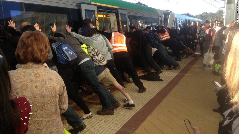 Dozens of commuters in Perth, Australia, work to rescue a man who got his leg trapped between a train and a platform on Wednesday, August 6. The passenger was able to wriggle free with their help.
