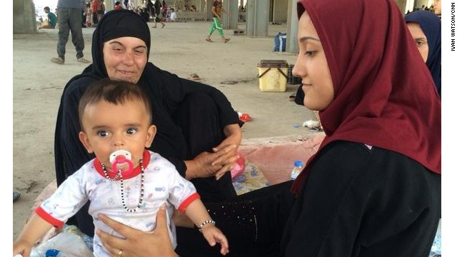 Six-month old Kathem, 1 of more than 10,000 Iraqis who fled ISIS to Erbil, taking shelter in an unfinished building on August 7, 2014.