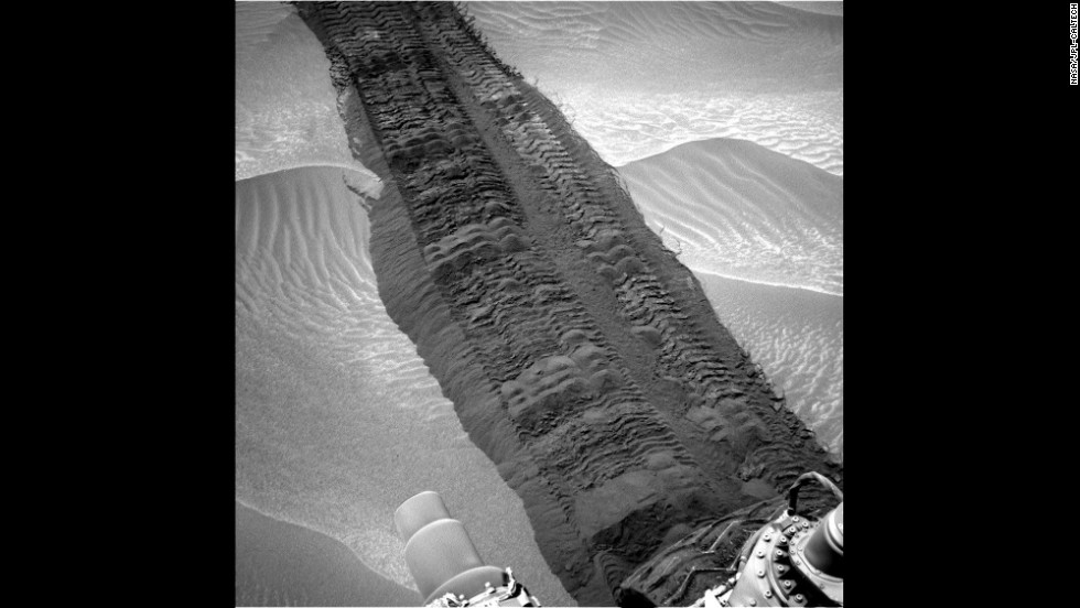 "Wheel tracks from Curiosity are seen on the sandy floor of a lowland area dubbed ""Hidden Valley"" in this image taken August 4."