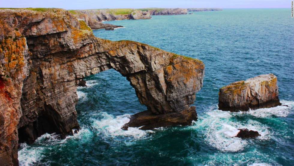 "<a href=""http://www.pembrokeshirecoast.org.uk/default.asp?pid=120"" target=""_blank"">The Green Bridge of Wales</a> on the rocky Pembrokeshire coastline is one of the most famous spots in Wales."