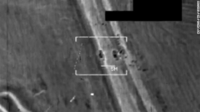 An image grab taken from a handout video released by the United States Central Command (Centcom) on August 8, 2014, shows a US military F/A-18 Hornet fighter jet strike on what the US army says is an Islamic State (IS) target at an undisclosed location in northern Iraq. US warplanes bombed jihadist positions in northern Iraq on August 8, 2014, in what the federal and Kurdish governments vowed would allow them to start clawing back areas lost in two months of conflict.