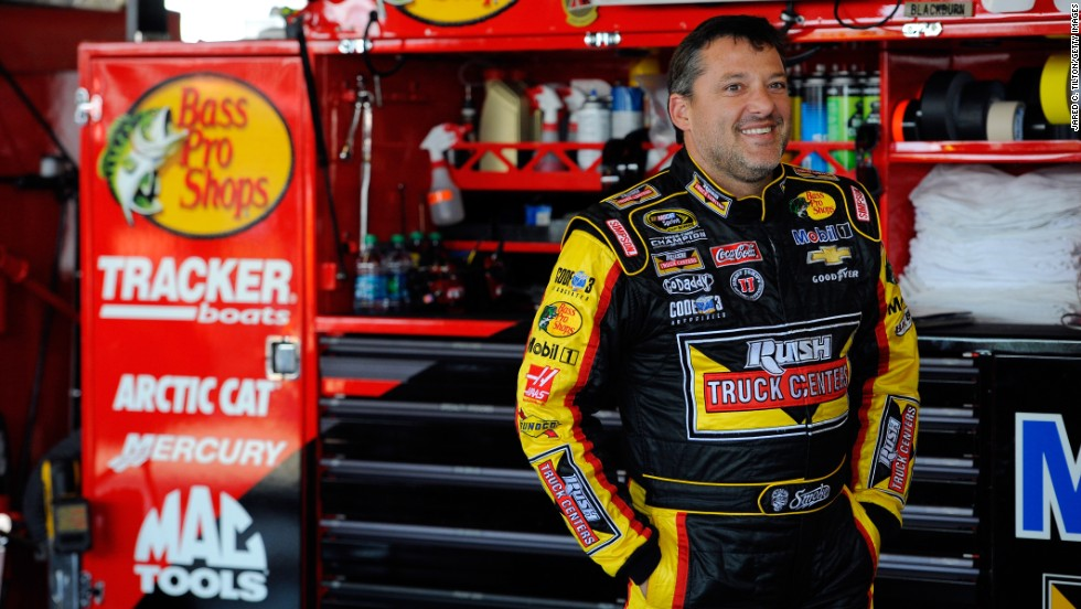 NASCAR driver Tony Stewart looks on in the garage area during practice for a race in Watkins Glen, New York, on Friday, August 8. Stewart is a three-time champion in NASCAR's top division.