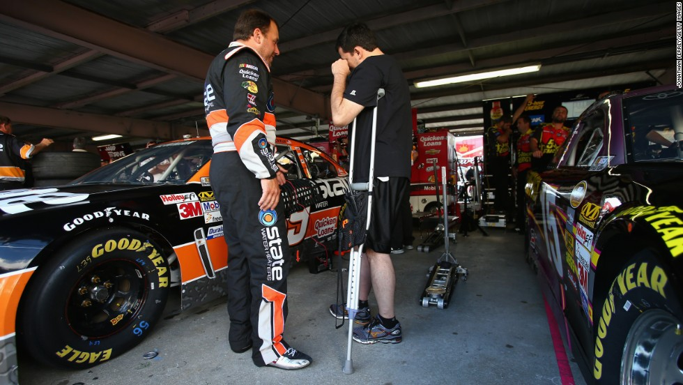 Driver Ryan Newman talks with Stewart in September 2013. Stewart broke his leg a month earlier during a race in Oskaloosa, Iowa.
