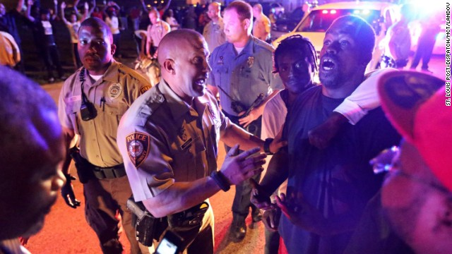 Image #: 31297030    Police officers speak to a man as they try to break up a crowd in Ferguson, Mo., on Saturday, Aug. 9, 2014. Earlier in the day police had shot and killed an 18-year-old man. (David Carson/St. Louis Post-Dispatch/MCT)      St. Louis Post-Dispatch/ MCT /LANDOV