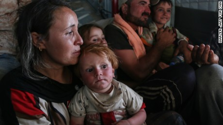 Aug 11, 2014, Iraqi Kurdistan-Zakho. A little girl name Helen, one year and 6 months after been rescued. A joint operation by the Iraqi air-force and Kurdish peshmerga flying by Iraqi air force helicopter over ISIS front lines on a dangerous mission to deliver food, water, diapers, milk and more some of the tens of thousands of Yazidi people who Kurdish officials says are still trapped on Sinjar Mountain.