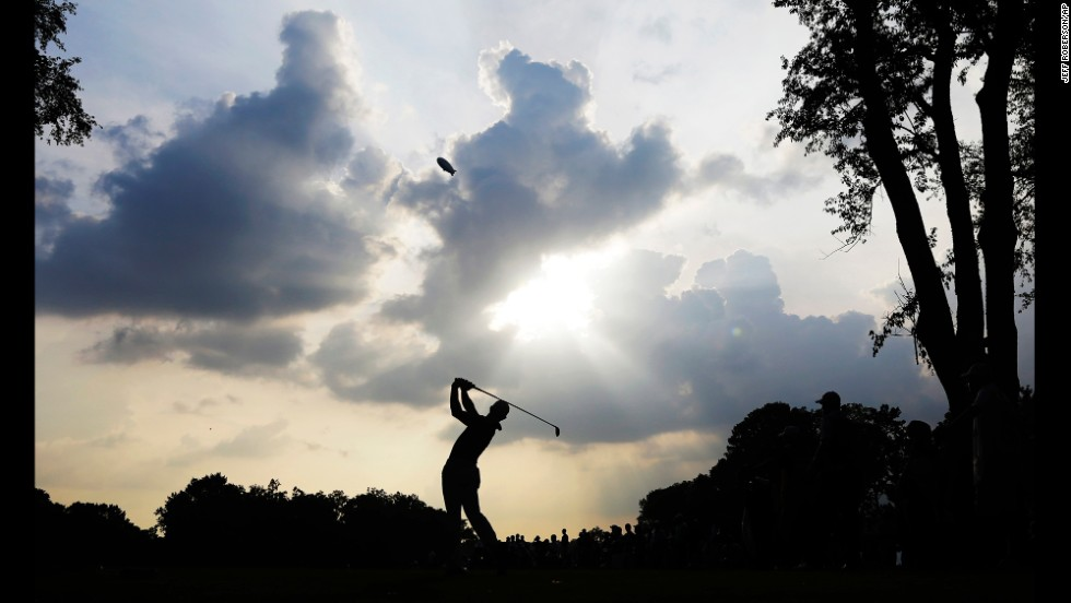 Rory McIlroy watches his tee shot on the 12th hole of Valhalla Golf Club during the final round of the PGA Championship, which was held Sunday, August 10, in Louisville, Kentucky. With darkness setting in after a lengthy rain delay, McIlroy held off Phil Mickelson, Rickie Fowler and Henrik Stenson to win the fourth major championship of his career.
