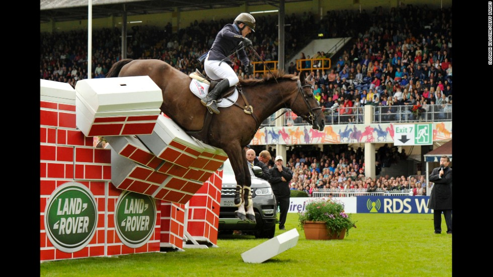Liam O'Meara, riding Cisero, fails to clear a wall during the high-jump competition at the Dublin Horse Show on Saturday, August 9.