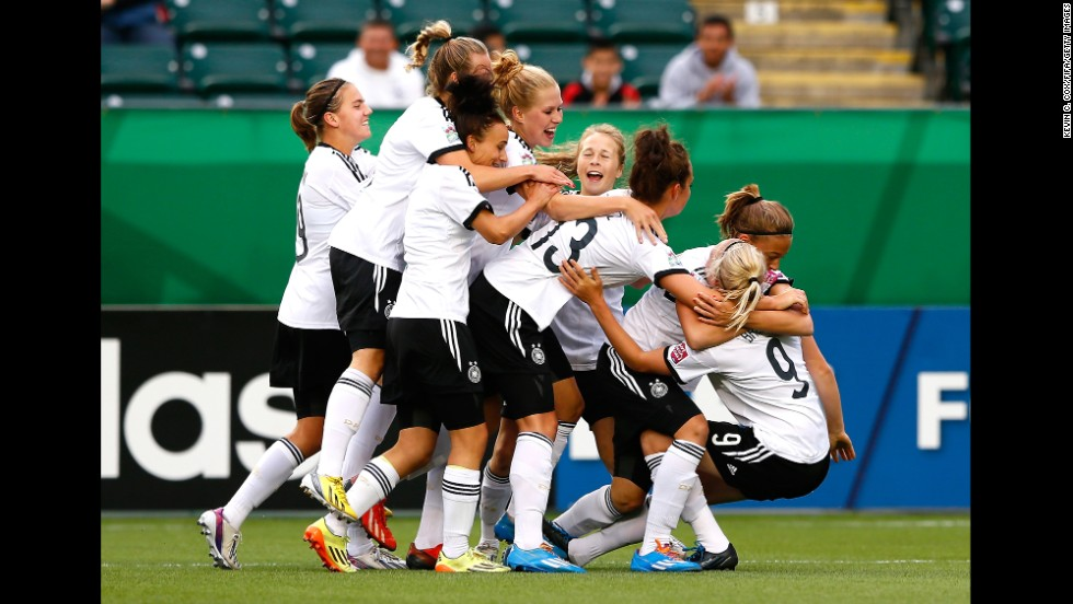 Pauline Bremer, far right, is mobbed by teammates after her goal gave Germany a 1-0 lead over China in their U-20 Women's World Cup match Friday, August 8, in Edmonton, Alberta. The match ended in a 5-5 draw.