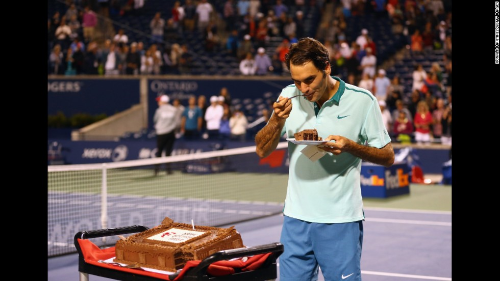 Tennis star Roger Federer has a piece of birthday cake Friday, August 8, after a quarterfinal win against David Ferrer in the Rogers Cup event in Toronto. Federer, who turned 33, eventually lost in the final to Jo-Wilfried Tsonga.
