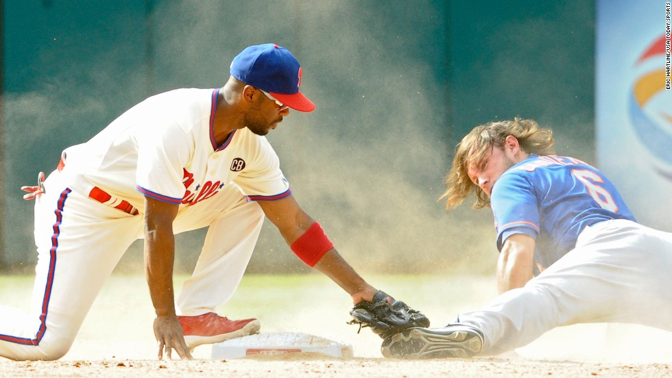 Philadelphia Phillies shortstop Jimmy Rollins tags out New York Mets center fielder Matt den Dekker during a steal attempt Sunday, August 10, in Philadelphia.