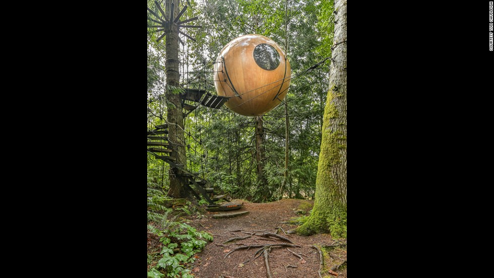 "<em>Free Spirit Spheres, Canada </em><em><br /></em>Hanging like wooden baubles in the temperate rainforest of Vancouver Island off the West coast of Canada, these spherical tree houses are designed to give a luxurious and sustainable forest experience<br />Each sphere is hand crafted and takes about three years to build. They use bio-mimicry, in this case taking their inspiration from nutshells, to create a tree house than can safely be suspended from ropes in the canopFree Spirit founder Tom Chudleigh writes: ""Our long range goal is to protect old growth forests ... we want to keep the footprint light enough so that it doesn't degrade the forest"""