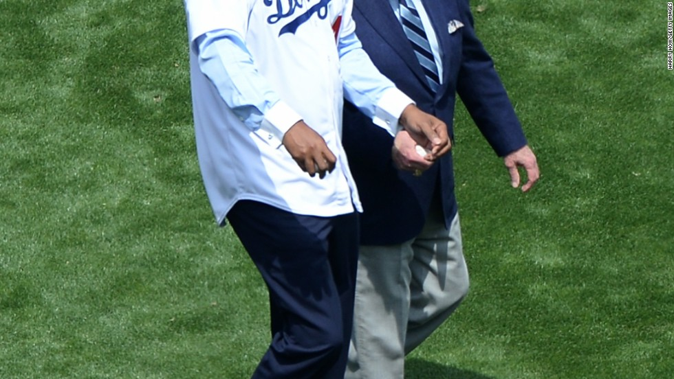 <strong>Honor the local deities.</strong><br />There are popular Angelenos, there are admired Angelenos. Then there are Angelenos who might as well be secular gods, they're so beloved. Basketball and business legend Magic Johnson (left) and immortal Dodgers baseball announcer Vin Scully (he's been with the team since 1950) unite locals like nothing else.