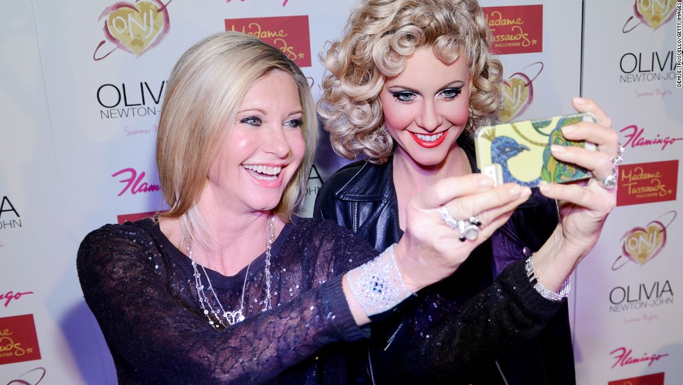 "Singer Olivia Newton-John snaps a selfie with her new wax figure Saturday, August 9, in Las Vegas. The figure shows Newton-John from her role in the 1978 movie ""Grease."""