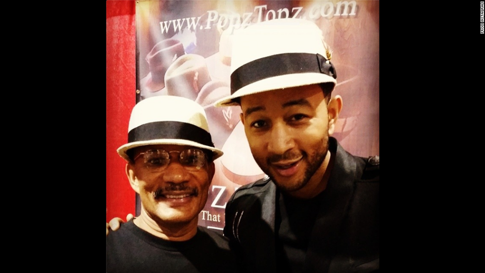 "Singer John Legend posted this <a href=""http://instagram.com/p/rcIFKwkSoY/"" target=""_blank"">Instagram photo</a> of him and his father on Friday, August 8. ""With my dad selling Popz Topz at the Neighborhood Awards in Atlanta!"" he said."