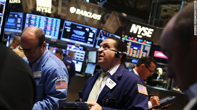 Traders work on the floor of the New York Stock Exchange (NYSE) on August 1, 2014 in New York City.