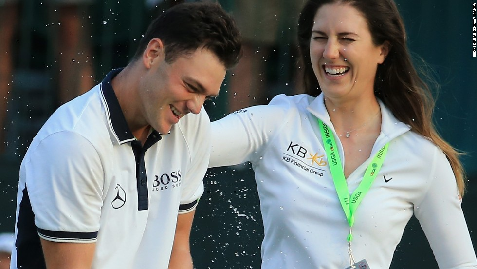 Kaymer is doused with water by fellow German and LPGA star Sandra Gal in June after adding to his 2011 PGA Championship triumph.