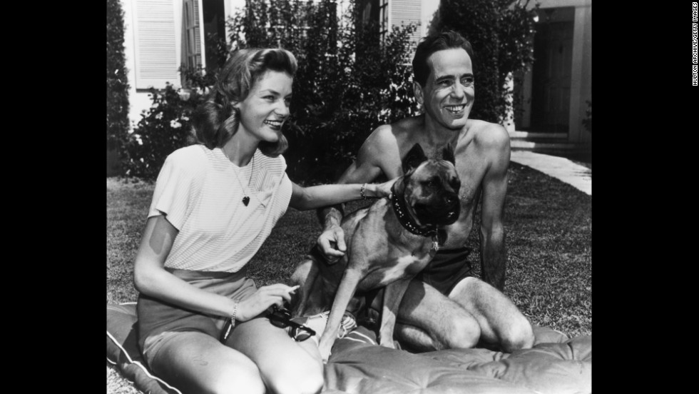 Bogart and Bacall at home with their dog in 1945.