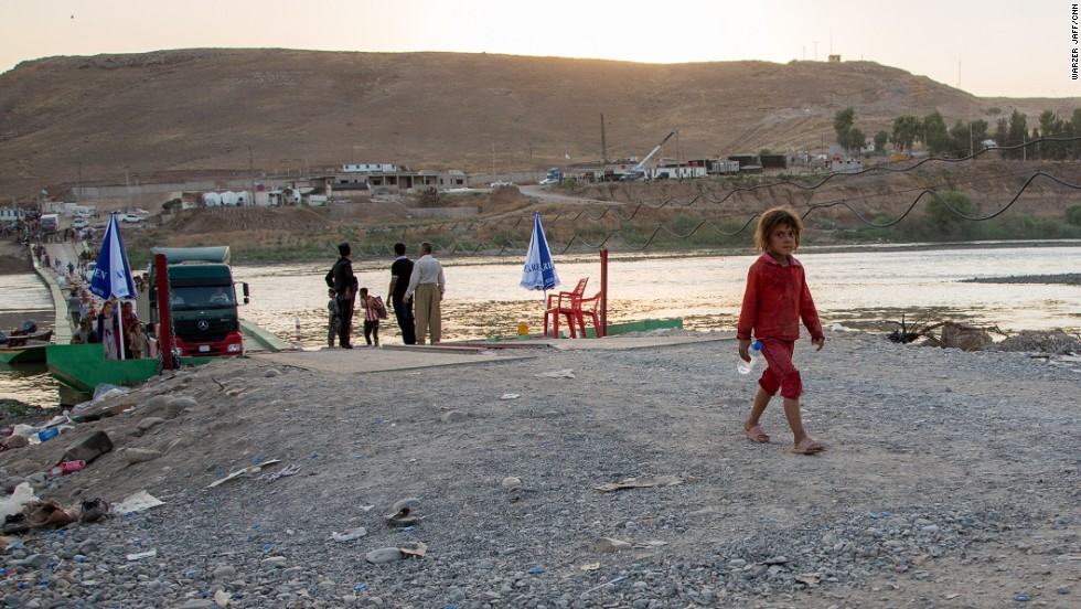 "A little girl was seen crossing the bridge by herself.<a href=""http://cnn.com/2014/08/12/world/meast/iraq-crisis/index.html""> The United States is sending more troops to northern Iraq,</a> a move that U.S. officials told CNN is necessary to help in the rescue of tens of thousands of Yazidis trapped in the mountains."