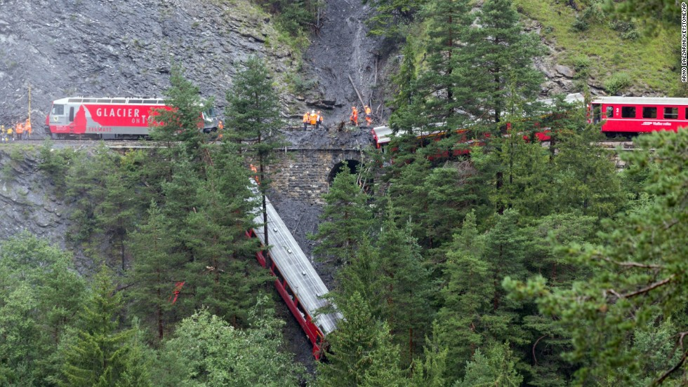 A derailed passenger train is pictured near Tiefencastel, Switzerland, on Wednesday, August 13. A landslide caused the train to partially derail in the Swiss Alps, injuring at least six people, regional police spokesman Peter Faerber said.