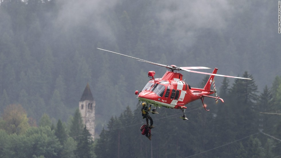 A helicopter transports emergency personnel to the passenger train accident.