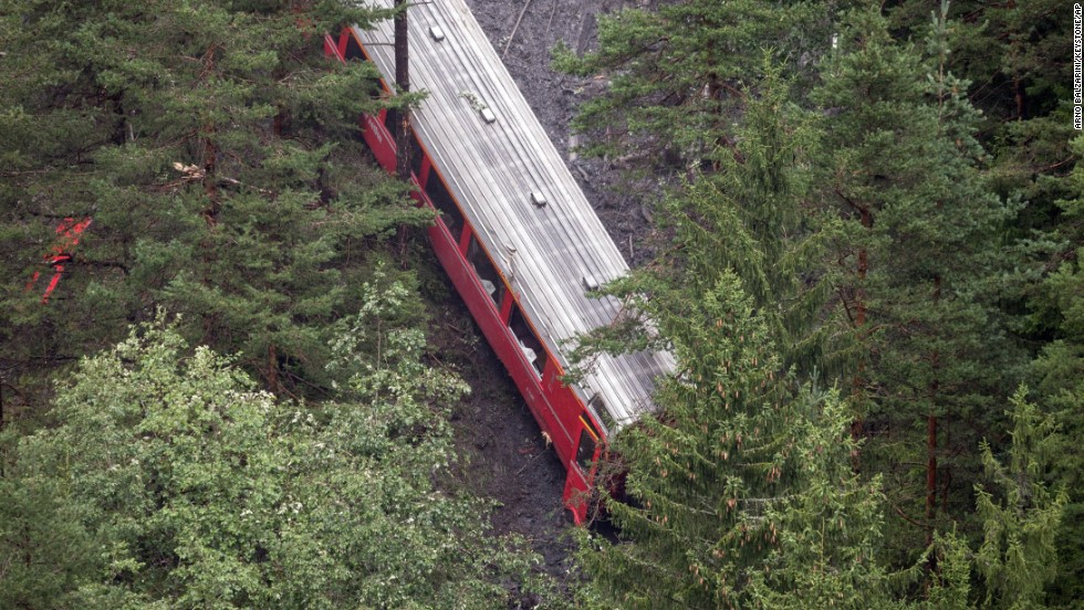 The derailed passenger train is pictured near Tiefencastel.