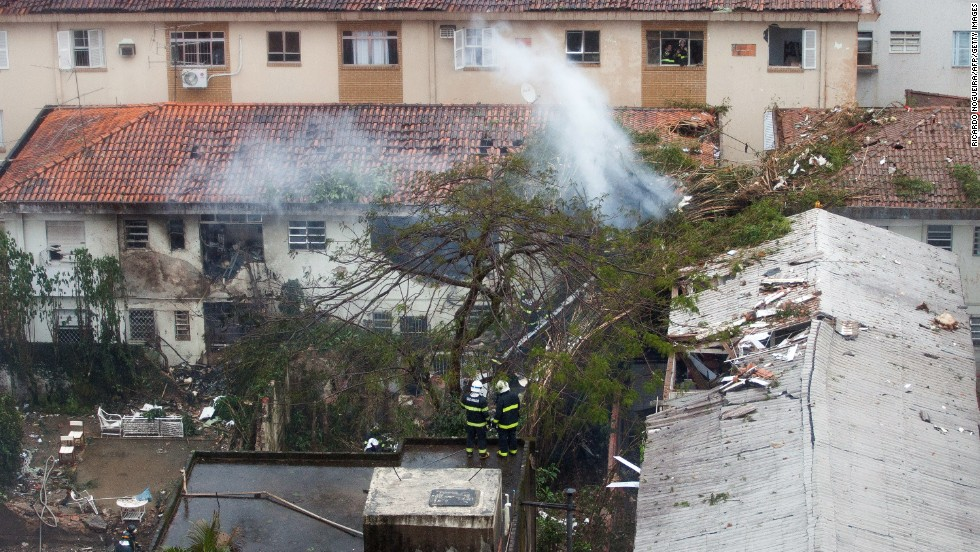 Rescuers work at the site of a plane crash in Santos, Brazil, on Wednesday, August 13. Among those on the small Cessna 560XL aircraft was Eduardo Campos, a Brazilian presidential candidate. All seven people aboard the plane were killed, state-run Agencia Brasil reported.