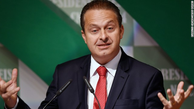 Former Pernambuco State governor Eduardo Campos, candidate of the Brazilian Socialist Party (PSB) for October's presidential election, speaks with businessmen at the National Agriculture Confederation headquarters in Brasilia, on August 6, 2014.