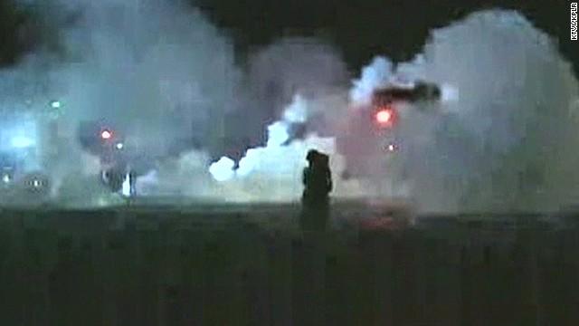 Ferguson police fire tear gas