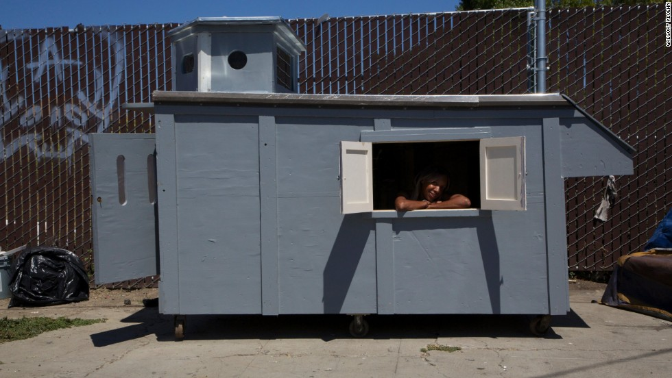 "Another sustainable approach to living is to build using recycled materials. Designer Gregory Kloehn did this by turning a dumpster into a fully functional home. He ""up-cycles"" washing machines, tires, bathroom and sun decks."