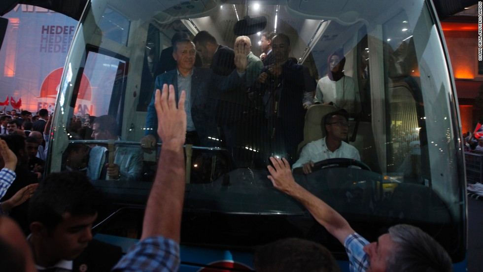 "Turkish Prime Minister Recep Tayyip Erdogan waves to a crowd Sunday, August 10, in Istanbul. By a wide margin of votes, Erdogan will become the country's first <a href=""http://www.cnn.com/2014/08/06/europe/gallery/turkey-election/index.html"">directly elected president,</a> the semi-official Anadolu News Agency reported."