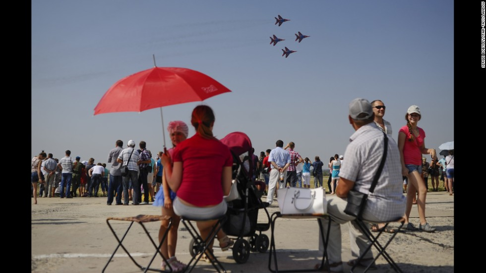 People attend an air show in Lipetsk, Russia, on Tuesday, August 12. It was Russian Air Force Day.