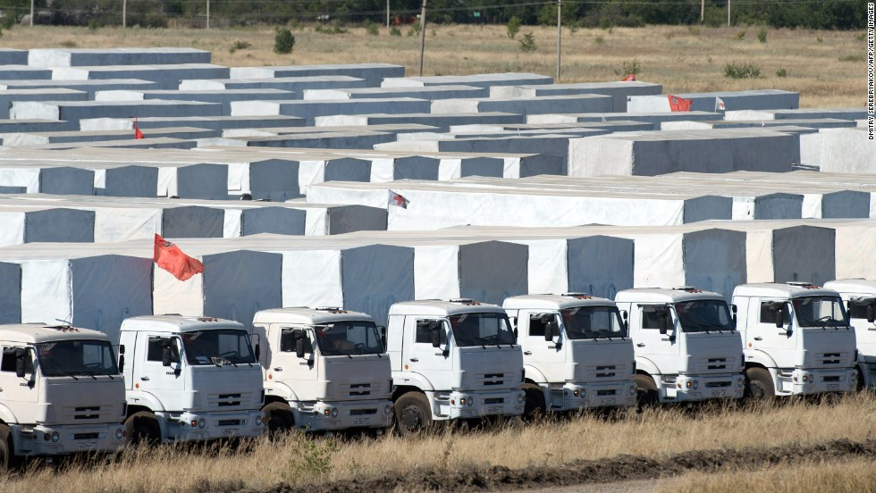 Trucks of a Russian humanitarian convoy are parked in a field outside the town of Kamensk-Shakhtinsky, in the Rostov region of Russia about 20 miles from the Ukraine border, on August 15. Ukrainian officials were preparing to inspect the convoy, which was bound for the conflict-torn east.