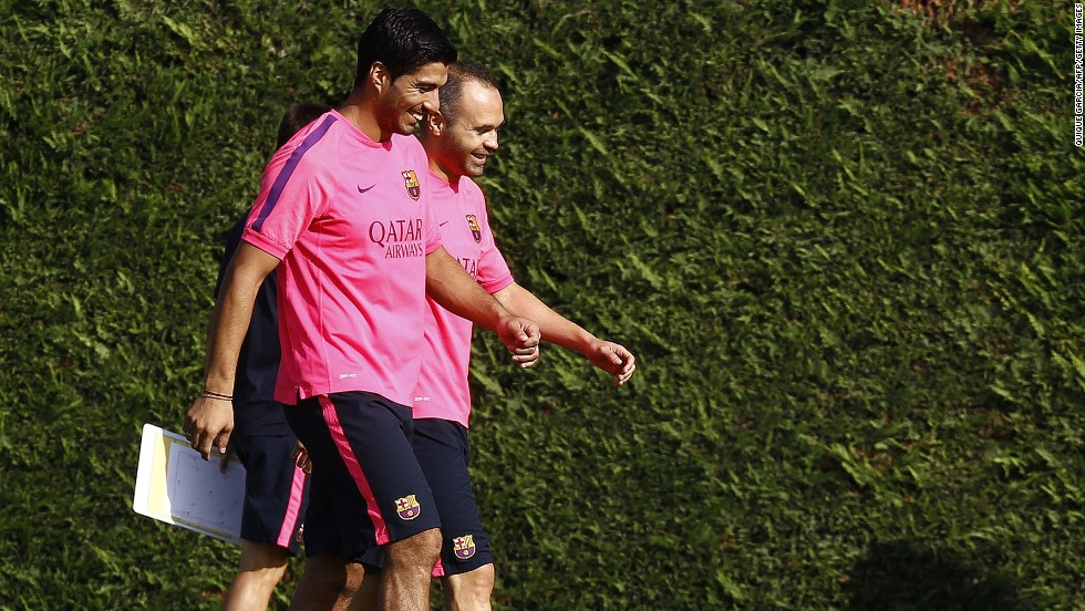 "Luis Suarez has completed his first training session with his Barcelona teammates. The Uruguayan lost his appeal to have his four-month ""biting ban"" reduced by the <a href=""http://cnn.com/2014/08/14/sport/football/luis-suarez-biting-ban-cas-barcelona/index.html"">Court of Arbitration for Sport</a> on Thursday but the restriction on him training with his new teammates was lifted. The former Liverpool player, seen here with Andreas Iniesta, cannot play competitive football for Barcelona until the end of October."