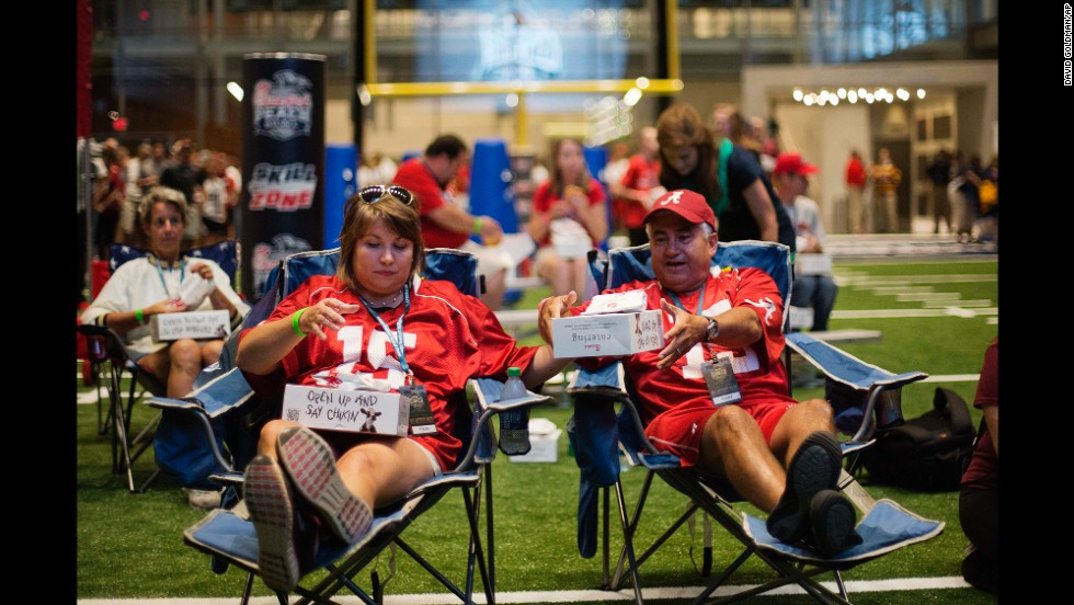 "Amy and Louis Valenzuela eat dinner at the Hall of Fame during the sleepover. ""It's awesome,"" said Amy, an Alabama fan. ""I think I already pulled my back, but it's so much fun."""