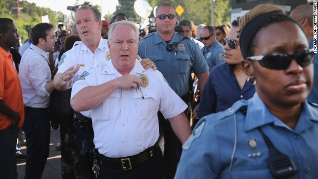 FERGUSON, MO - AUGUST 15:  Ferguson Police Chief Thomas Jackson leaves the parking lot of a gas station, which was burned during rioting, after he announced the name of the Ferguson police officer responsible for the August 9, shooting death of teenager Michael Brown on August 15, 2014 in Ferguson, Missouri. The officer was identified as Darren Wilson, a six year veteran of the police department. Brown's killing sparked several days of violent protests in the city.  (Photo by )