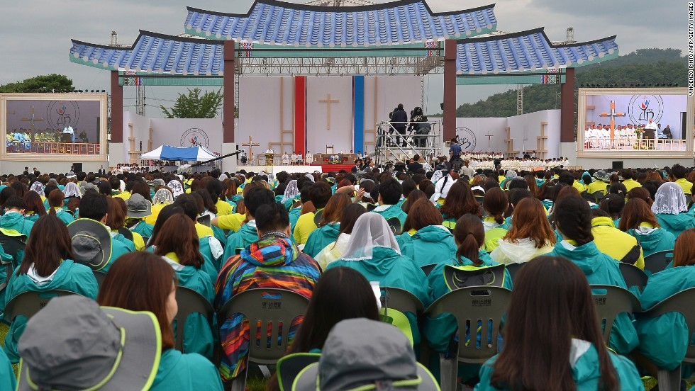 Young Catholics attend a Mass conducted by Pope Francis on August 17.