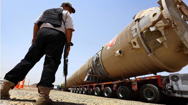 A section of an oil refinery is brought on a lorry to the Kawergosk Refinery, some 20 kilometres east of Arbil, the capital of the autonomous Kurdish region of northern Iraq, on July 14, 2014. The International Energy Agency (IEA) said on July 11, that an offensive by jihadists in northern Iraq had cut output by 260,000 barrels a day in June to 3.17 million, after fighting forced the closure of the country's biggest refinery and slashed production from the giant Kirkuk field