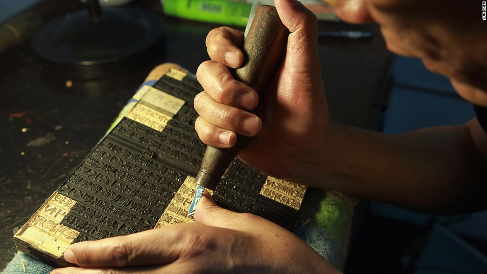 Buddhist scroll engravers carve sutras onto wooden blocks that are printed onto paper. Then, the scrolls are sorted and bound by hand.