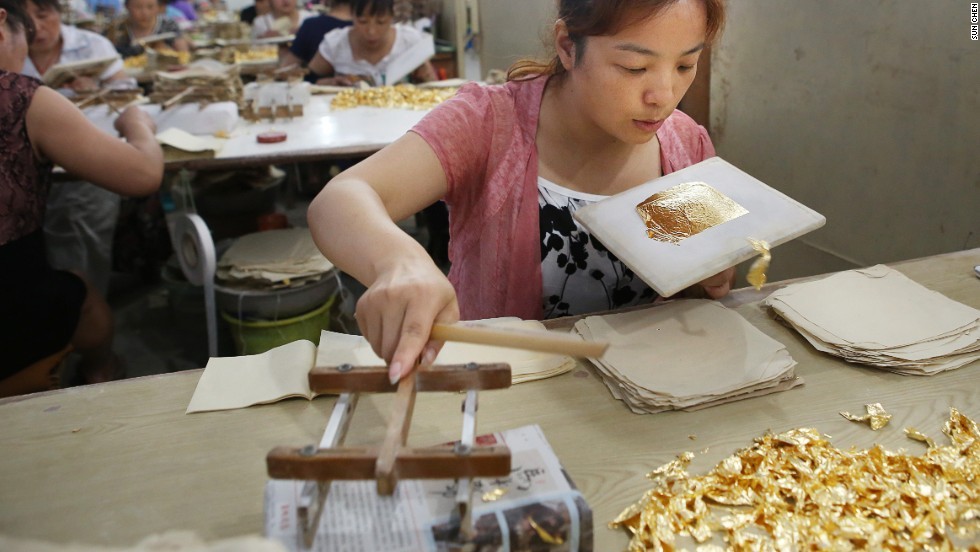 """There were gold leaves everywhere in the studio,"" says Nanjing-based photographer Sun Chen, who visited this gold leaf workshop. ""I have never seen that much gold in my life."""