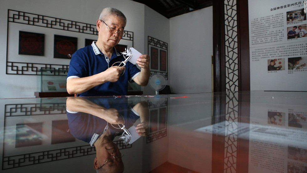 Among China's community of paper-cutting artists, Zhang is the first to have been recognized by the government as a senior handicraft and art master.