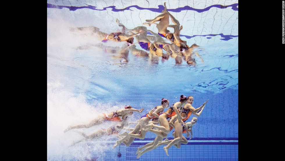 Synchronized swimmers from Belarus are seen underwater during their routine Wednesday, August 13, at the European Swimming Championships in Berlin.