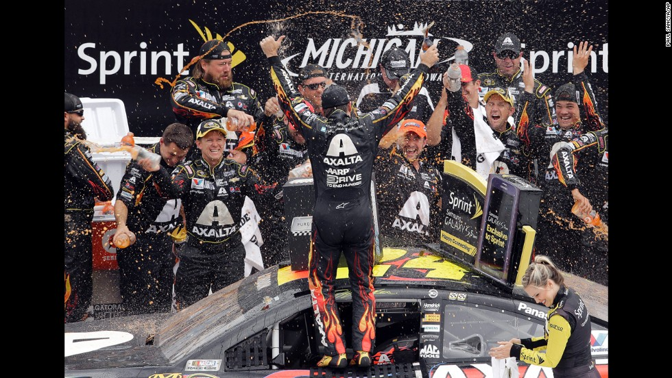 NASCAR driver Jeff Gordon celebrates with his crew after winning the Sprint Cup race at Michigan International Speedway on Sunday, August 17. It was his third victory of the year.